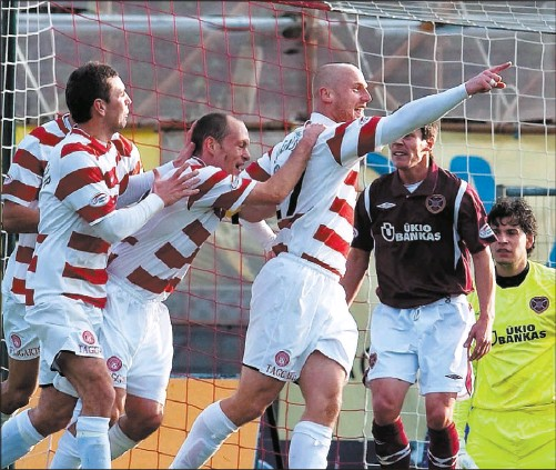??  ?? Simon Mensing celebrates netting the the second goal for Accies which in the end secured a vital win against Hearts