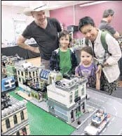 ?? PHOTO: Coral Cooksley ?? LEGO FUN: Aron McLean with his partner Sabrina and their children Indigo and Ocean at the amazing Lego exhibition held in the Senior Citizen›s Hall - part of the Golden Horses Shoes Festival activities for children in the town over the Easter long...