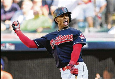 ?? JASON MILLER/GETTY IMAGES ?? Cleveland Indians superstar shortstop Francisco Lindor hit 38 home runs and led the AL in runs last season, but a calf injury could keep the all-star off the field until early April.