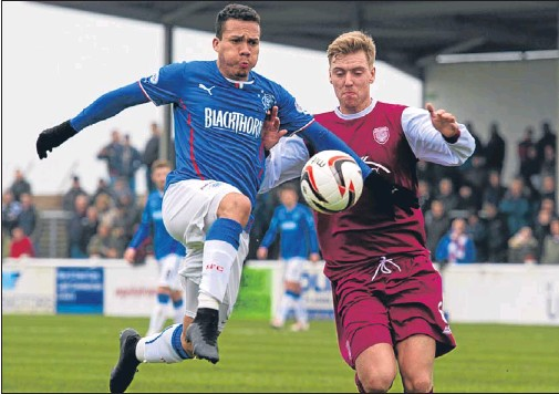 ?? Picture: SNS Group. ?? Rangers' Arnold Peralta battles for the ball with Arbroath's Johnny Lindsay.
