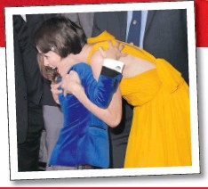 ??  ?? First Man star Claire Foy on the red carpet at the film's US premiere and hugging 10-year-old child actor Gavin Warren, who plays the couple's son Rick