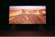 ??  ?? On display in a darkened room, The Atacama Lines featured photographs of ancient geoglyphs carved into the South American desert gradually mutating into signs of invading European life.