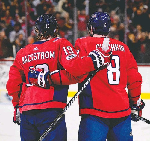 ?? NICK WASS/ASSOCIATED PRESS ?? After more than a decade of postseason disappointment, Alex Ovechkin and Nicklas Backstrom will get to play in the Stanley Cup finals for the first time.