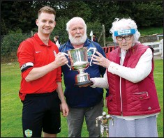 ??  ?? Grey­stones cap­tain Sean Minogue gets the cup from Syd­ney Byrne O'Reilly.