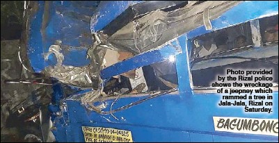 ?? Photo provided by the Rizal police shows the wreckage of a jeepney which rammed a tree in Jala-Jala, Rizal on Saturday. ??