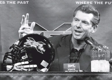 ?? ED BAILEY/ASSOCIATED PRESS ?? Vince McMahon, shown in 2000 speaking about the XFL, announced Thursday that he's restarting the defunct league.