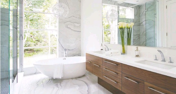 ??  ?? This bright and airy bathroom by AYA Kitchens aims to provide a luxurious retreat, featuring both a free-standing tub for long soaks, as well as a walk-in shower.