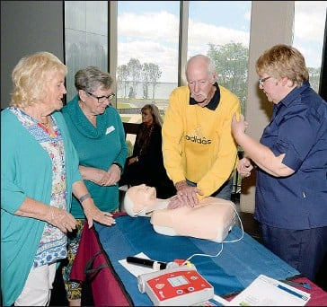 ??  ?? Mulwala resident Liz Seeliger, Cr Gail Law of Federation Council, Corowa resident Frank McKenna and Corowa Health Nurse Catherine Stanley with CPR dummy 'Annie' at ClubMulwala as part of the Federation Council's Festival of Fun for Seniors.