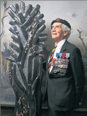 ?? Pictures: Colin Mearns ?? Ian Forsyth MBE next to the sculpture entitled France 1914 by artist Simon Burns-Cox