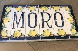 ??  ?? Tiles that spell out the couple's surname were picked up while they were on holiday on the Amalfi Coast in Italy.