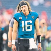 ?? CARMEN MANDATO GETTY IMAGES ?? No. 1 draft pick Trevor Lawrence had a rough start as the Jaguars were blown out 37-21 in Houston. The rookie threw for 332 yards and three touchdowns, but also had three interceptions.