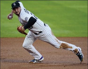 ?? ASSOCIATED PRESS FILE PHOTO ?? Colorado Rockies third baseman Nolan Arenado has earned his eighth consecutive Gold Glove award.