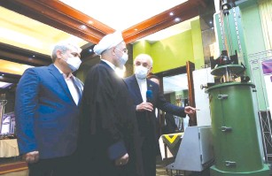 ?? (Iranian Presidency Office/WANA via Reuters) ?? IRANIAN PRESIDENT Hassan Rouhani reviews Iran's new nuclear achievements during National Nuclear Energy Day in Tehran on Saturday.