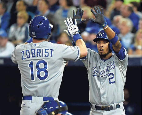 ?? DAN HAMILTON, USA TODAY SPORTS ?? Ben Zobrist and Alcides Escobar celebrate Zobrist's two-run homer in the first inning of Game 4 on Tuesday in Toronto.