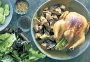 ?? David Malosh, © The New York Times Co. ?? Baked Chicken With Young Jackfruit, a fragrant, family-style dinner that mostly comes together in one pot.