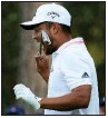 ?? (AP/Charlie Riedel) ?? Xander Schauffele expresses his frustration after taking his second tee shot on the 16th hole during the final round Sunday at the Masters in Augusta, Ga. His first tee shot went into the water.