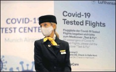 ??  ?? A flight attendant stood in front of the entrance of a new Lufthansa coronavirus quick-test center on Thursday at the Munich, Germany, airport. The airline started antigen test runs on selected routes.