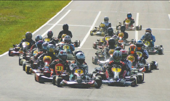 ?? CALGARY KART RACING CLUB ?? Kart racers in action on the Strathmore Motorsports Park track, 30 minutes east of Calgary and the site of the North of 49 Karting Championships July 22 to 25.