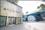 ?? Wilfredo Lee Associated Press ?? LUXURY STORES in Miami are proliferating as wealthy Latin Americans invest in real estate.