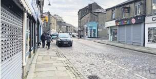 ??  ?? Bank Street in Rawtenstall virtually deserted during lockdown