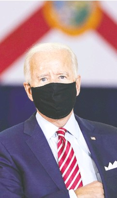 """?? DREW ANGERER/ GETTY IMAGES ?? As the U. S. presidential election draws near, pundits are weighing the odds that Donald Trump will win again. """"I'm rolling my dice at the Trump casino,"""" says Jeff Roe, while Terry Sullivan says the numbers favour Joe Biden."""