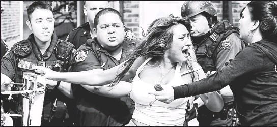 ??  ?? LIKE MOTHER, LIKE DAUGHTER: Sonni Sottile, agitated over the arrest of her boyfriend, scuffles with cops at her Mill Basin home before they pin her to the ground in front of her already-cuffed mom, Debra Russo (below). The women sued the city claiming...