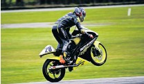 ?? PHOTO: MJSMYTH IMAGES ?? Wheel up and away . . . Southland rider Cormac Buchanan celebrated a trifecta of wins during the Southern Race Series at Teretonga Raceway in Invercargill last weekend.