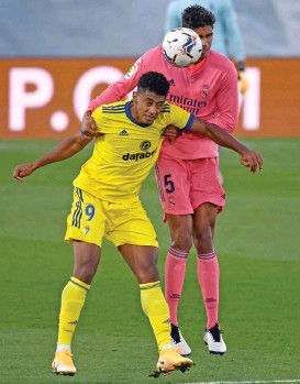 ??  ?? Cadiz's Anthony Lozano (left) vies with Real Madrid's Raphael Varane during the Spanish League game on Saturday