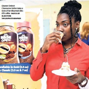 ?? PHOTOS BY GLADSTONE TAYLOR/PHOTOGRAPHER ?? Gleaner Online's Chevounne Getten takes a taste of her Mountain Bliss 876 coffee.