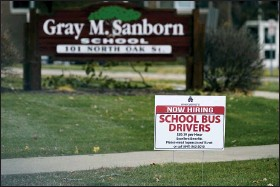 ?? NAM Y. HUH — THE ASSOCIATED PRESS ?? A hiring sign shows outside of Gray M. Sanborn Elementary School in Palatine, Ill., Nov. 5.