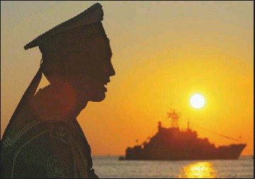 ?? AGENCE FRANCE-PRESSE/GETTY IMAGES ?? A sailor watches the sunset after a celebration of the 225th anniversary of the Russian Black Sea Fleet in the in May.