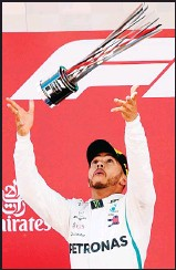 ??  ?? Mercedes' British driver and first place winner Lewis Hamilton celebrates on the podium after the Spanish Formula One Grand Prix at the Circuit de Catalunya in Montmelo in the outskirts of Barcelona on May 13. (AFP)