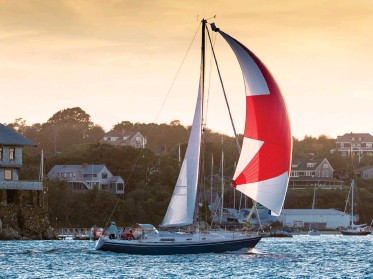 ??  ?? Known by any number of names, an asymmetric spinnaker can turn a downwind run home into a spirited way to end the day.