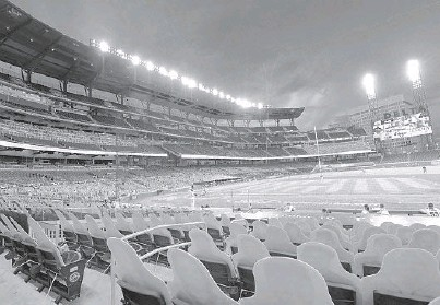 ?? JOHN AMIS/AP ?? During the shortened 2020 season, cardboard cutouts of fans occupied seats at a baseball game in Atlanta.