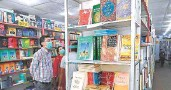 ?? AFP ■ ?? Freedom to read: Customers browsing books at a store in Lahore earlier this month.