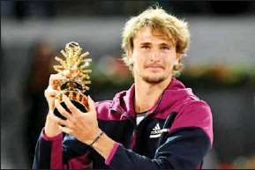 ?? AFP ?? Germany's Alexander Zverev holds the winner's trophy after beating Italy's Matteo Berrettini during their 2021 ATP Tour Madrid Open tennis tournament singles final match on May 9.