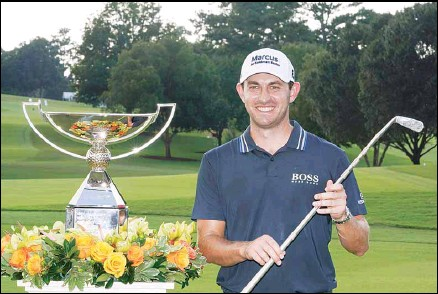 ?? Atlanta. (AP) ?? Patrick Cantlay poses with the trophies after winning the Tour Championship golf tournament and the FedEx Cup at East Lake Golf Club, on Sept. 5, in