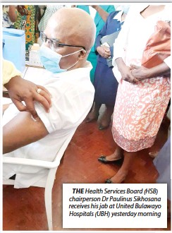 ??  ?? THE Health Services Board (HSB) chairperson Dr Paulinus Sikhosana receives his jab at United Bulawayo Hospitals (UBH) yesterday morning