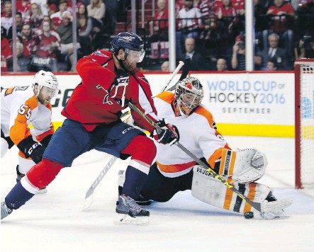 ?? ALEX BRANDON/ THE ASSOCIATED PRESS ?? Washington Capitals defenceman Karl Alzner can't get the puck past Philadelphia Flyers goalie Michal Neuvirth during the second period of Game 5 in their first-round playoff series, Friday, in Washington.