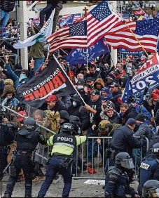 ?? ROBERTO SCHMIDT/AFP | AFP ?? Trump supporters clash with police and security forces as they storm the U.S. Capitol in Washington on Jan. 6.