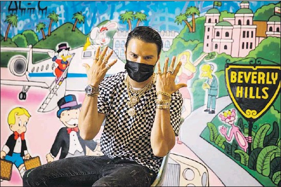 52a8ea6495fc Photographs by Kent Nishimura Los Angeles Times. ALEC MONOPOLY shows off  the bling. The street artist ...
