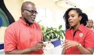 ??  ?? Sales Manager of The Gleaner Company Rainford Wint has a heart-toheart with Commercial and Corporate Affairs Manager of Salada Tamii Brown about Mountain Bliss 876 coffee.