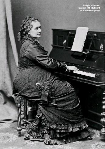??  ?? Upright at home: Clara at the keyboard of a domestic piano