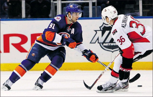 """?? — MCT ?? The New York Islanders' John Tavares (91) said playing at an Olympics would be a """"once in a lifetime opportunity,"""" but he said that he and his teammates can't let that distract them from the task at hand, winning at the IIHF world men's championship."""