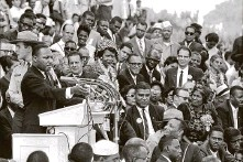 """?? Associated Press file photo ?? Martin Luther King Jr. addresses thousands in Washington, D.C., during his """"I Have a Dream"""" speech in 1963."""