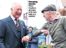 ??  ?? Bumping elbows Prince Charles is all smiles as he says hello to a resident
