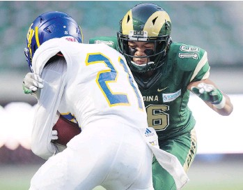 ?? TROY FLEECE ?? UBC's Trey Kellogg is tackled by University of Regina defender Korey Sheppard-Greene at Mosaic Stadium in Regina. The Rams rolled to a 36-20 victory in the Sept. 1 showdown.
