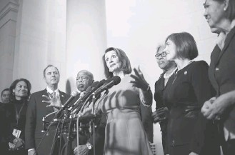?? SARAH L. VOISIN/THE WASHINGTON POST ?? The Democratic Party's leading voice will probably be Rep. Nancy Pelosi (Calif.), center, who is on track to return as House Speaker.