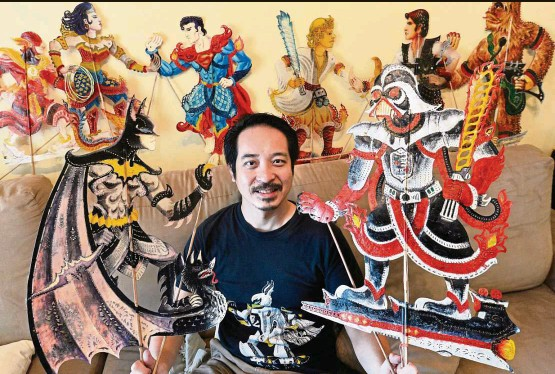 ??  ?? Chuo with some of his pop-culture inspired puppets. He's holding 'Batman' on the left and 'Darth Vader' on the right. — ONG SOON HIN/The Star