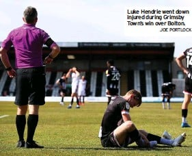 ?? JOE PORTLOCK ?? Luke Hendrie went down injured during Grimsby Town's win over Bolton.